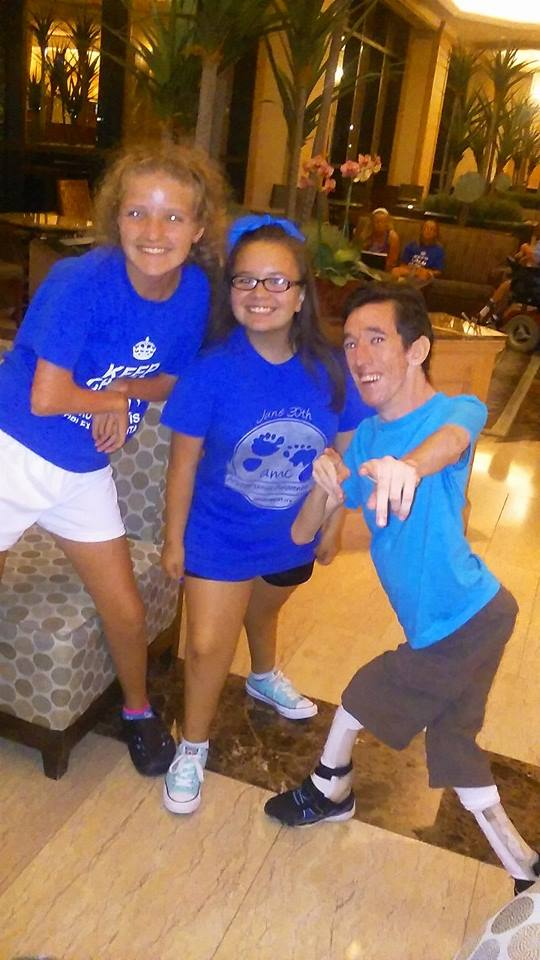 Photo of Marty and 2 teen girls in the hotel lobby. All three have Arthrogryposis.
